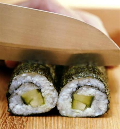 Cutting Both Halves Of Your Sushi At Once Will Ensure More Even Pieces