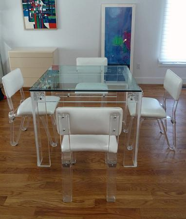 Glass, Acrylic, or Lucite Tables And Chairs Aren't Quite Invisible, But They're Clear Enough To Leave Your Room A Little More Open