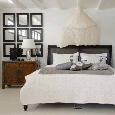 Several Identical Mirrors In Matching Frames Can Create A Window Like Effect And Visually Double Your Room